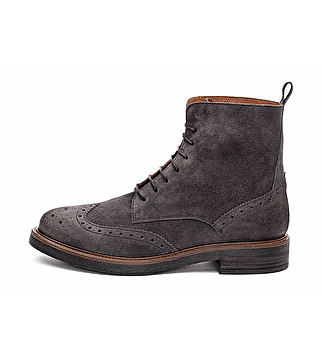 Suede combat boot with dovetail design